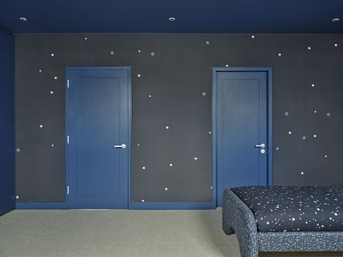Blue doors in a kids bedroom.