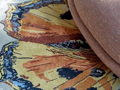 A hand made silk rug with animals from Stark Rugs