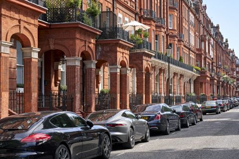 An image of red brick period luxury properties in London.